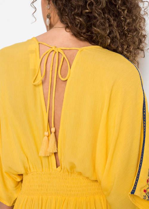 Žluté dámské šaty s vázačkou na zádech